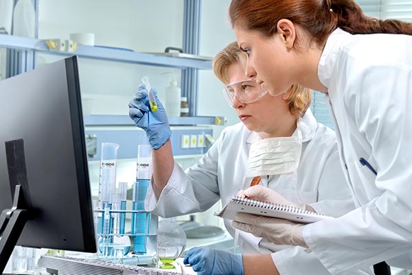 Two women working in a lab