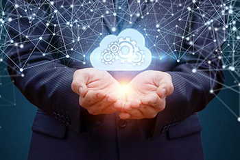 cupped hands with image of cloud with connected nodes