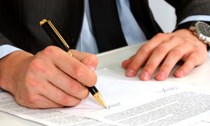 Man signing financial document