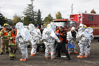 team of firefighters and hazmat cleanup crew