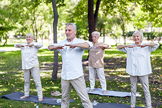 Elderly exercising outside
