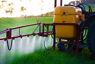 farm machinery spraying pesticides