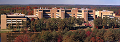 Panoramic photograph of main NIEHS building, taken from across the lake, atop the adjacent Environmental Protection Agency (EPA) building
