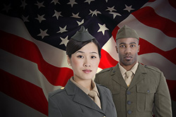 male and female soldier in front of United States Flag