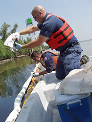 Oil technicians collecting water sample