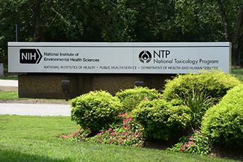 Front of NIEHS building with sign