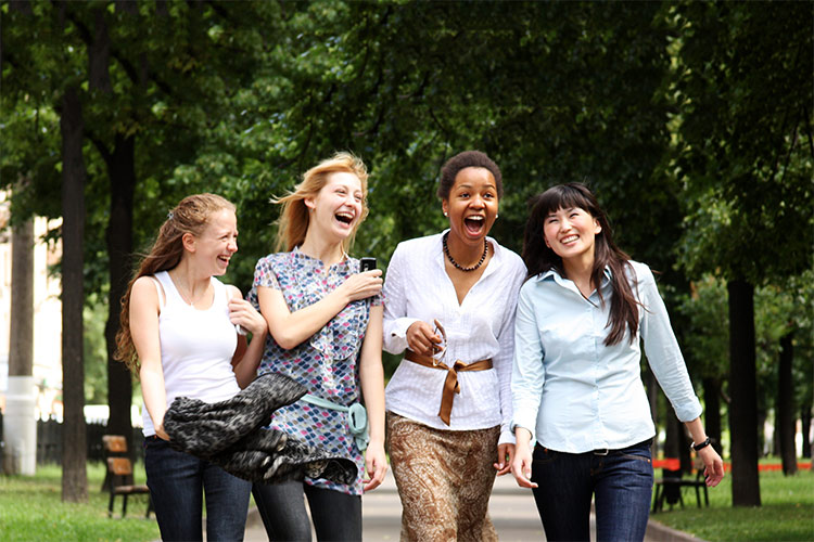 group of four women laughing