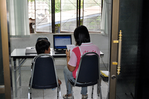 Research assistant  conducting Behavioral Assessment Research System with child.