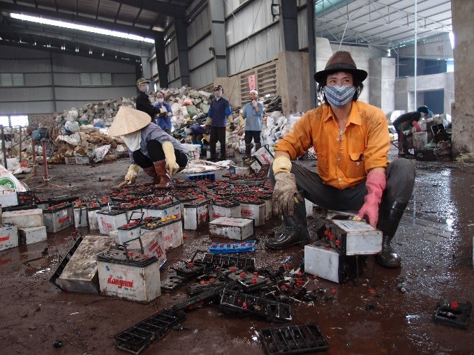 Worker in a lead battery recycling facility