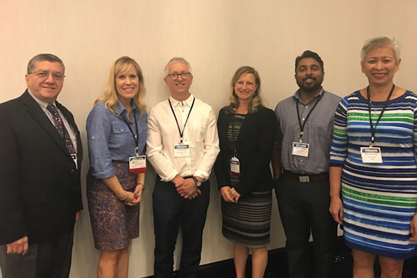 NIEHS staff and grantees pose at iCOMOS from L to R: Jose Cordero., Kimberly Thigpen Tart, , Frank Von Hippel.,  Heather Henry, Nishad Jayasundara, Maureen Lichtveld.