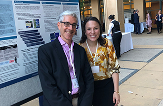 Caitlin Rublee and John Balbus posing together during a recent poster session