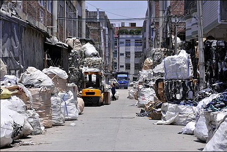 Trash piled up along a street
