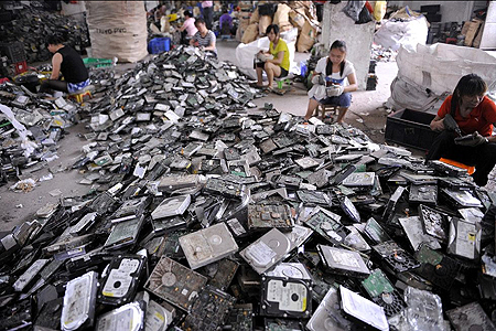 people working in a ewaste recycling plant