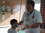 doctor and child in Argentine hospital
