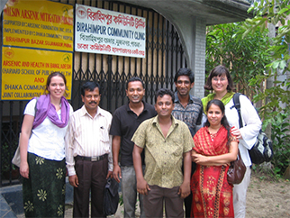 Kile (back row, extreme right) with her team in front of one of the Birahimpur community clinics.