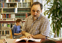 Man reading a book in the Library