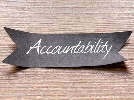 a black ribbon with the word accountability written on it