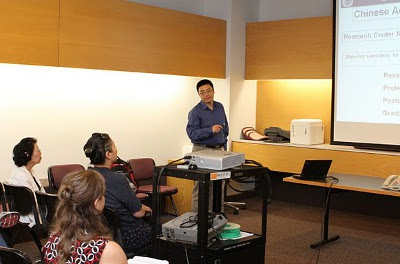 Bin Zhao, Ph.D., presents his latest research to NIEHS staff