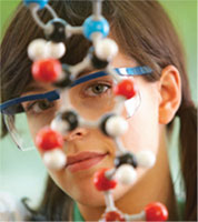 woman looking at chemical structure