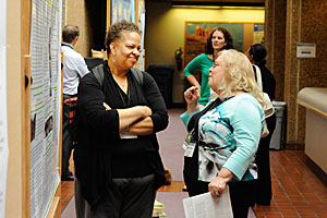 Neasha Graves, left, speaks with Marti Lindsey, Ph.D., of the University of Arizona at a PEPH meeting.