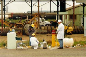 Scientists in protective gear perform a push-pull test.