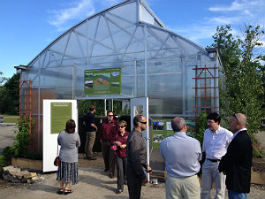 People standing outside a greenhouse