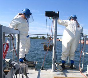 researchers collecting data in water