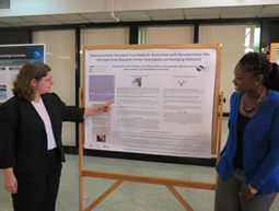 Kelli Palmer (right), from the LSU SRP Research Translation Core (RTC) discusses the SRP RTC poster with Amanda Brown (left), an instructor in industrial hygiene at Southeastern Louisiana University .