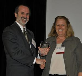 photo of Maier receiving her award.