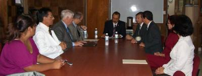 University of Arizona officials meeting with UACT officials at a boardroom desk.