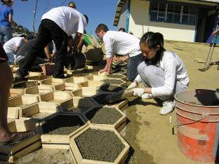 UCSD students work with residents to build pervious concrete brick in a local schoolyard.