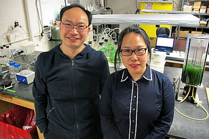 Two researchers from Wayne State University standing in a lab