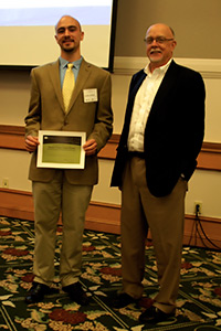 Adrion, left, received his poster award from Suk during the awards announcements.