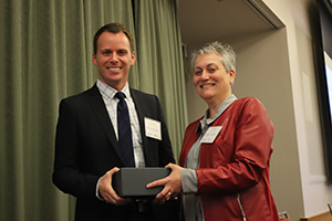 Gwen Collman, Ph.D., NIEHS Director of the Division of Extramural Research, presented trainee Brad Newsome, Ph.D., from the University of Kentucky SRP Center, with the 2014 Karen Wetterhahn Memorial Award (see story).