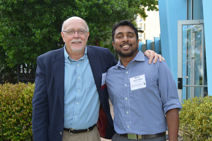 Suk, left, congratulated Nishad Jayasundara, Ph.D., the 2015 Karen Wetterhahn Memorial Award winner. Jayasundara, a postdoctoral researcher at Duke University, is the 18th recipient of the award.