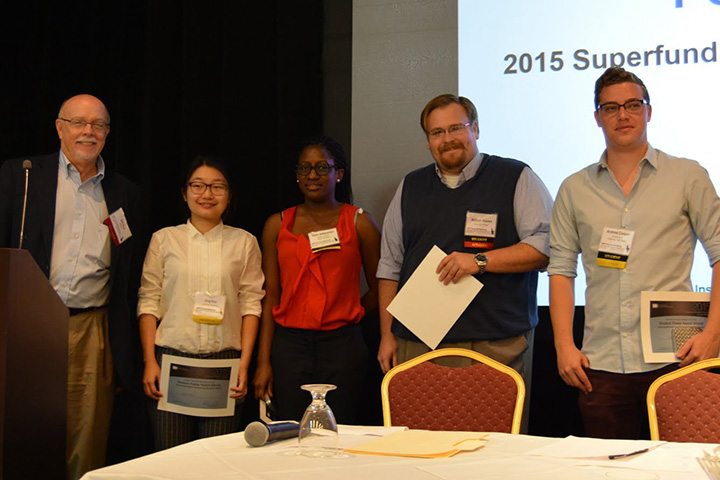 Suk, left, posed with the four students who won poster awards. In the environmental sciences and engineering category, the winners were Andrew Cooper, right, from the University of California, San Diego, and Jing Sun, second from left, from Columbia University. In the health sciences category, the winners were Oluwadamilare Adebambo, center, from North Carolina State University and the University of North Carolina at Chapel Hill SRP Center, and William Klaren, second from right, from the University of Iowa.