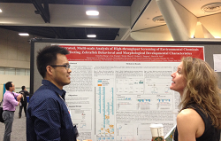Zhang and Heacock talk during the SOT 2015 poster session