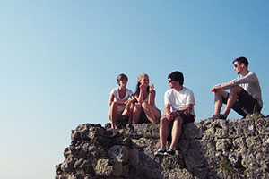 Teenagers sitting on a rock