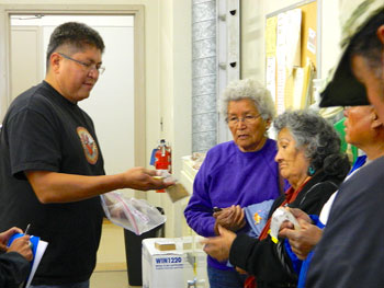 Through his work with the Northern Arizona University Center for American Indian Resilience (CAIR), Rock shows community members from Cameron, Arizona, how environmental samples are processed in the lab