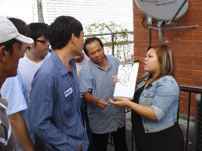 "Tap Bui, right, a community organizer at the MQVN Community Development Corporation, uses ""power mapping"" to educate community members."