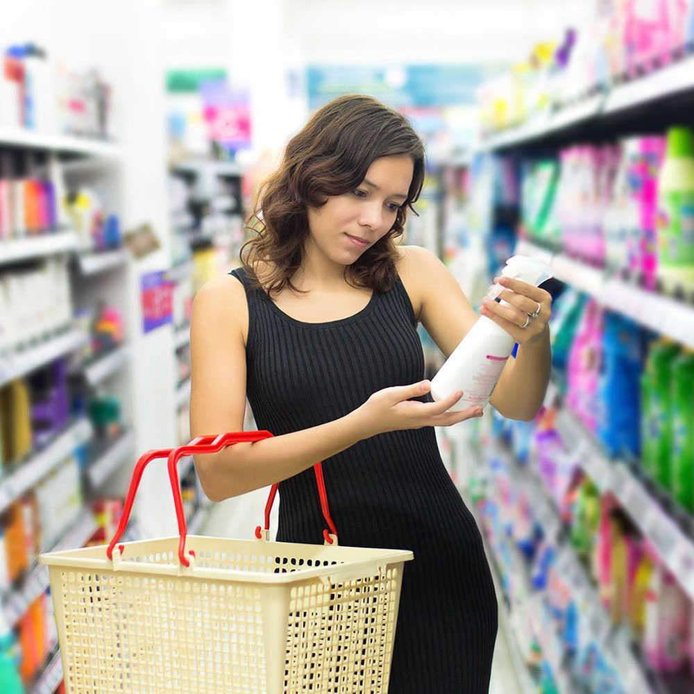 woman looking at products in grocery store