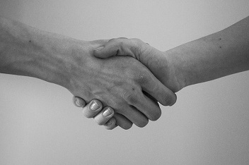 A handshake in black and white